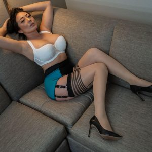 Nyssa Nevers posing on a couch