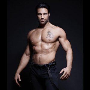 Charles Dera shirtless in black slacks